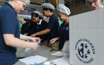 "Milner Middle School Students Help Cigna ""Support Squad"" Pack Nutritious Meals on Universal Children's Day"